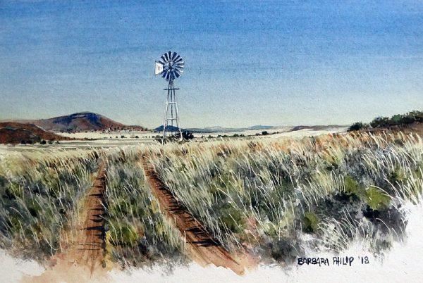 Windmill and farm track. Karoo