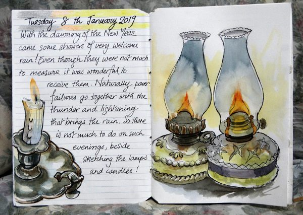 Paraffin lamps and a candlestick